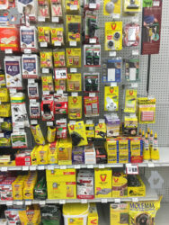 A photo of a sales wall showing various rodent control products