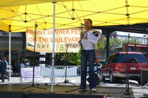 Kerry McLean, Vice President of Community Development, onstage at Bronx Summer Fest 2016.