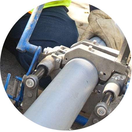 Plumber using a hydraulic device to repair a sewer trenchlessly