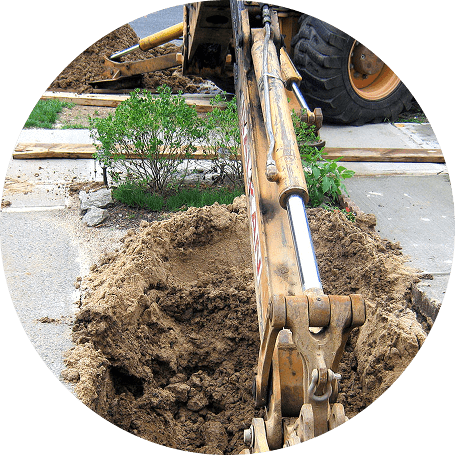 Excavating a trench for sewer replacement