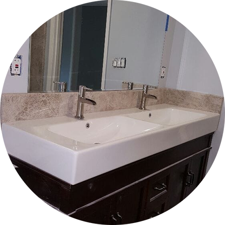 New faucets in a new vanity with double sinks