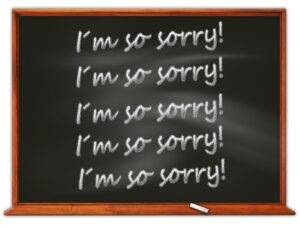 blackboard with i'm so sorry written 5 times