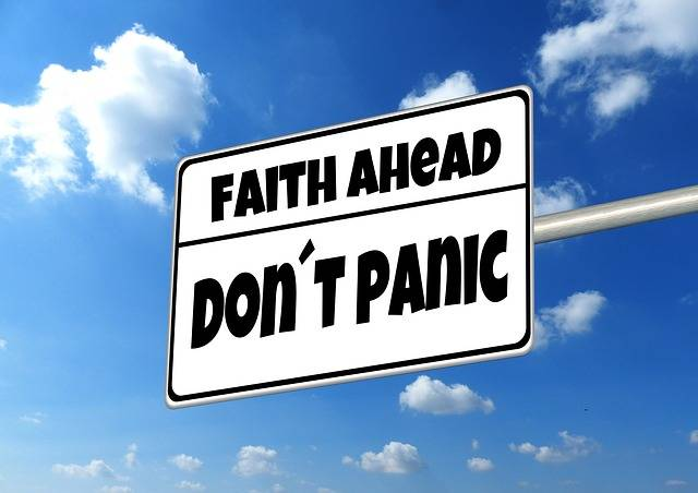 directional sign, faith ahead, don't panic