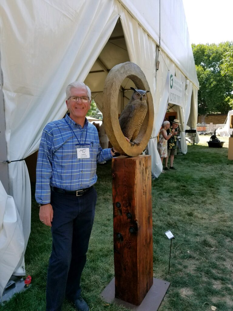 Me with my Great Horned Owl sculpture at the 2018 Loveland Sculpture in the Park