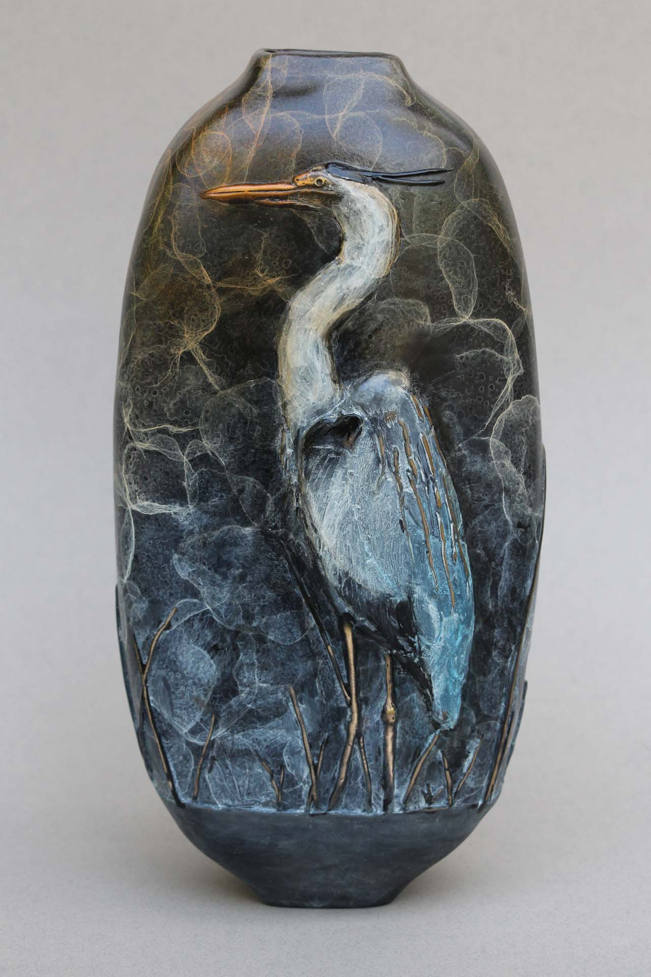 Side 1 of the Great Blue Heron vase. The Blue Heron standing at attention.