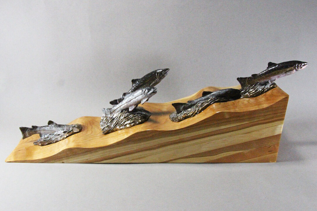Migrating Salmon. The water is represented by cherry wood