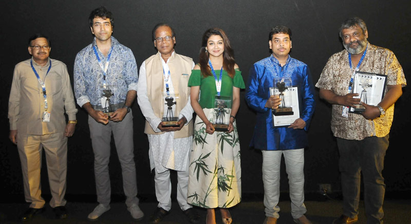 Director Kaushik Ganguly with the cast and crew of the film BISORJON, at the presentation, during the 48th International Film Festival of India