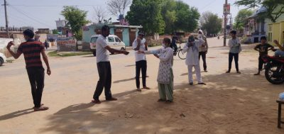 Central University of Haryana distributes masks in villages, chanting 'Stay at Home Stay Protected'