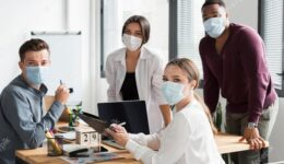 working-team-office-during-pandemic-wearing-face-masks_23-2148666331