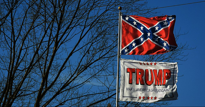 Confedrate and Trump flags flying together