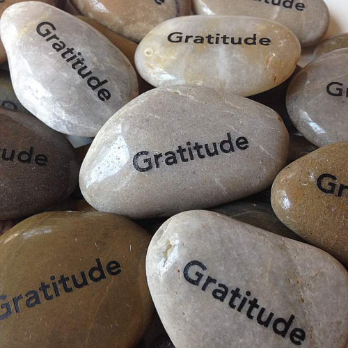 Stones marked with the word gratitude