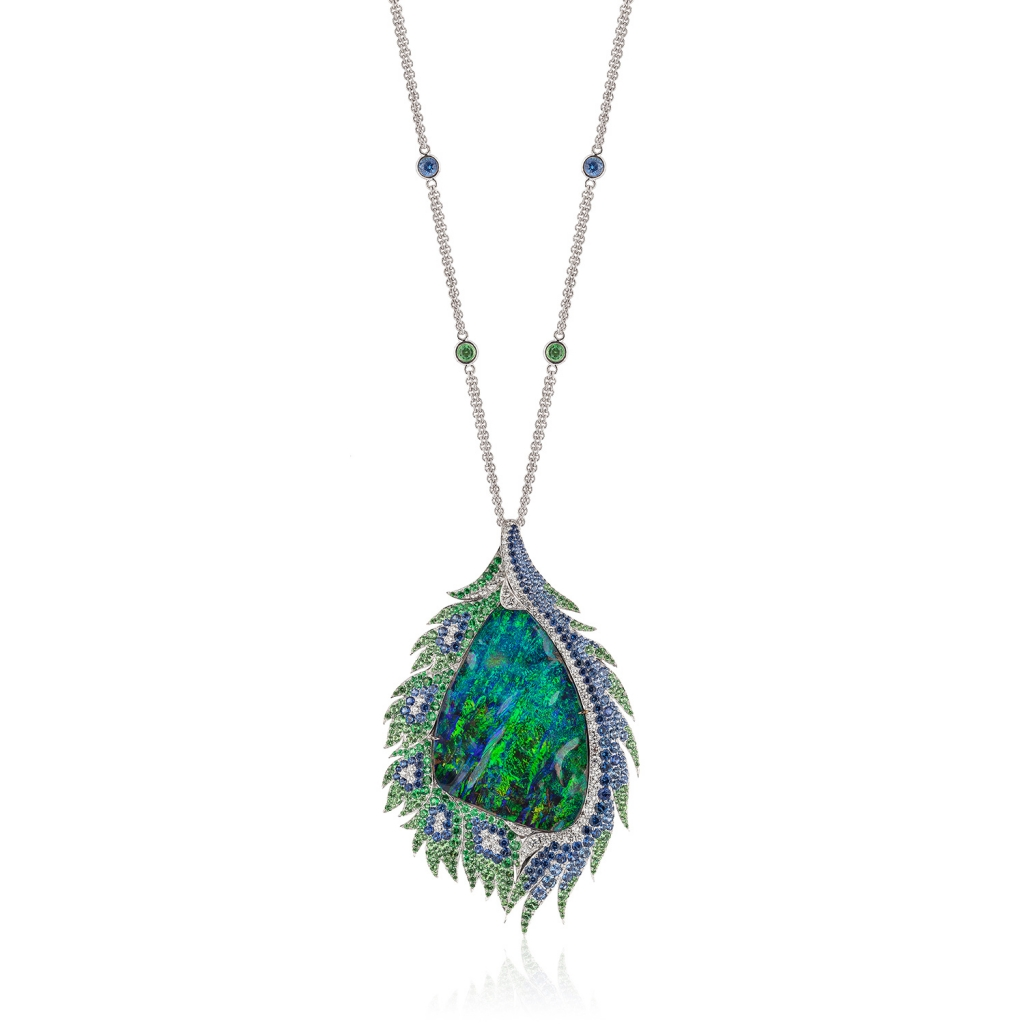 Pendant necklace in 18k white gold with a 49.80 ct. boulder opal, 3.77 cts. t.w. blue sapphires, 3.11 cts. t.w. tsavorite garnets, and 1.12 cts. t.w. diamonds by Tanja Schuetz of DuftyWeis Opals, Inc.