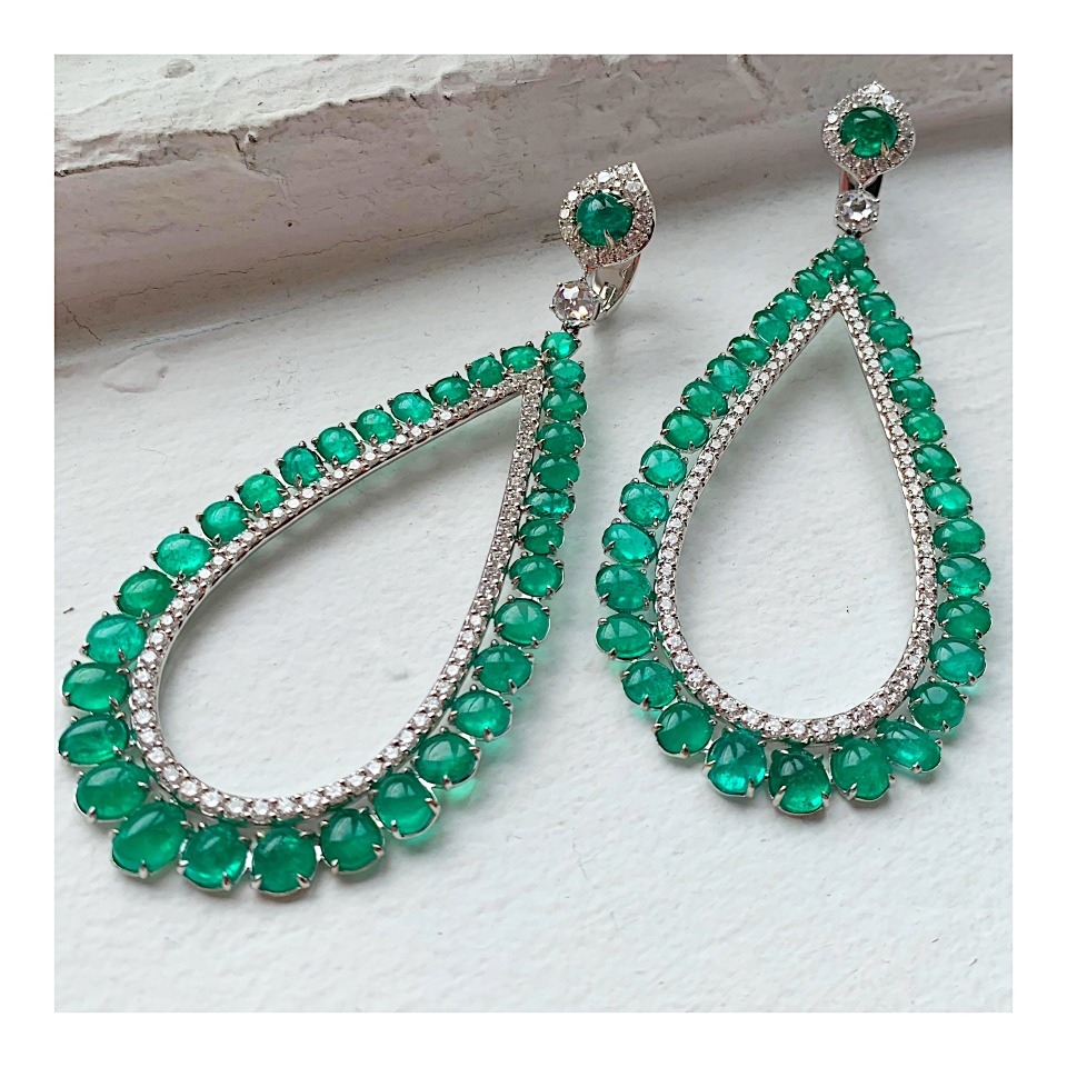 Oversize drop earrings in 18k white gold with 38.25 cts. t.w. emerald cabochons and 6.11 cts. t.w. diamonds by Muzo Emeralds