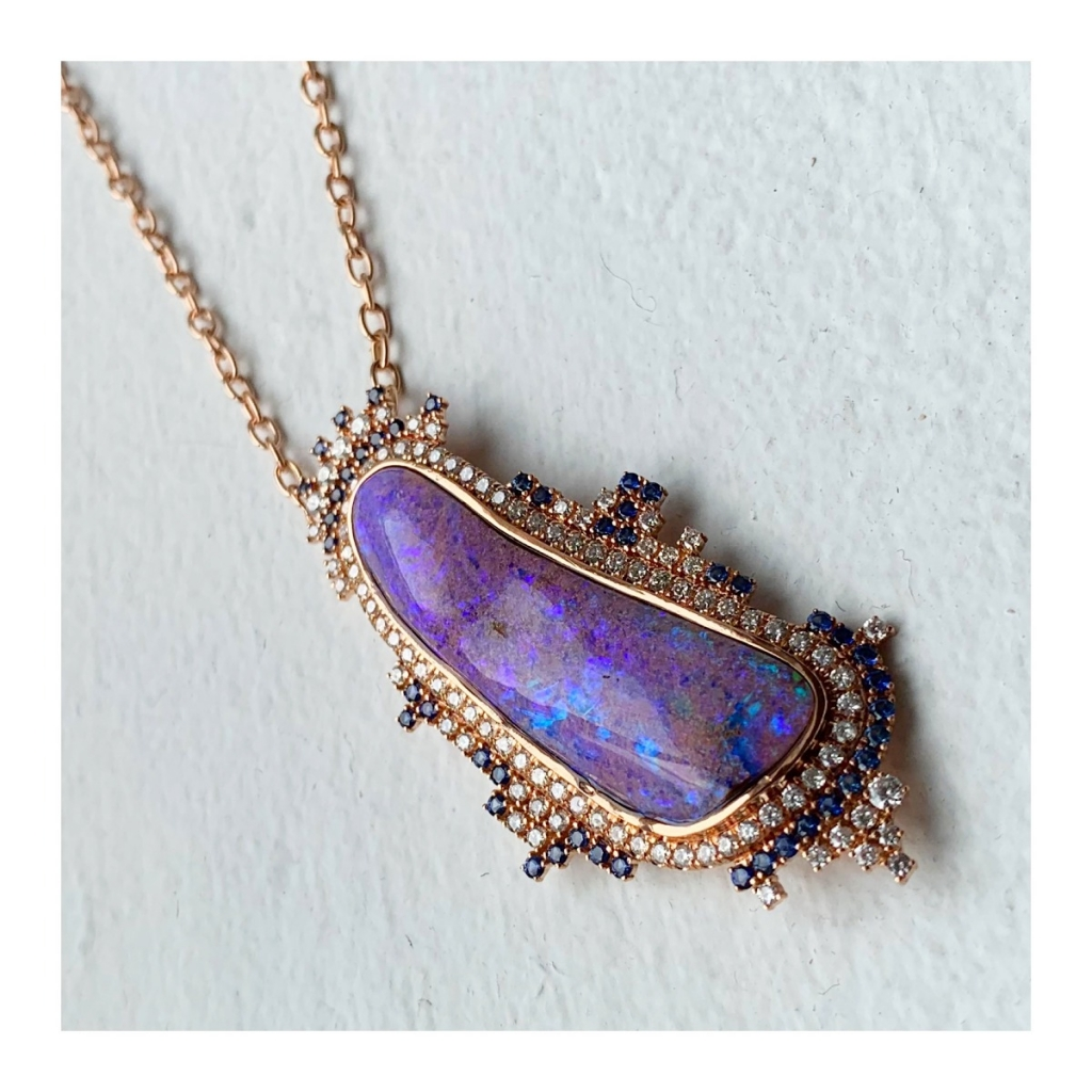 Pendant necklace in 18k yellow gold with a 20.9 ct. black opal, 1.21 cts. t.w. diamonds, and 0.77 ct. t.w. sapphires by Michael Hezar of Michael John Jewelry