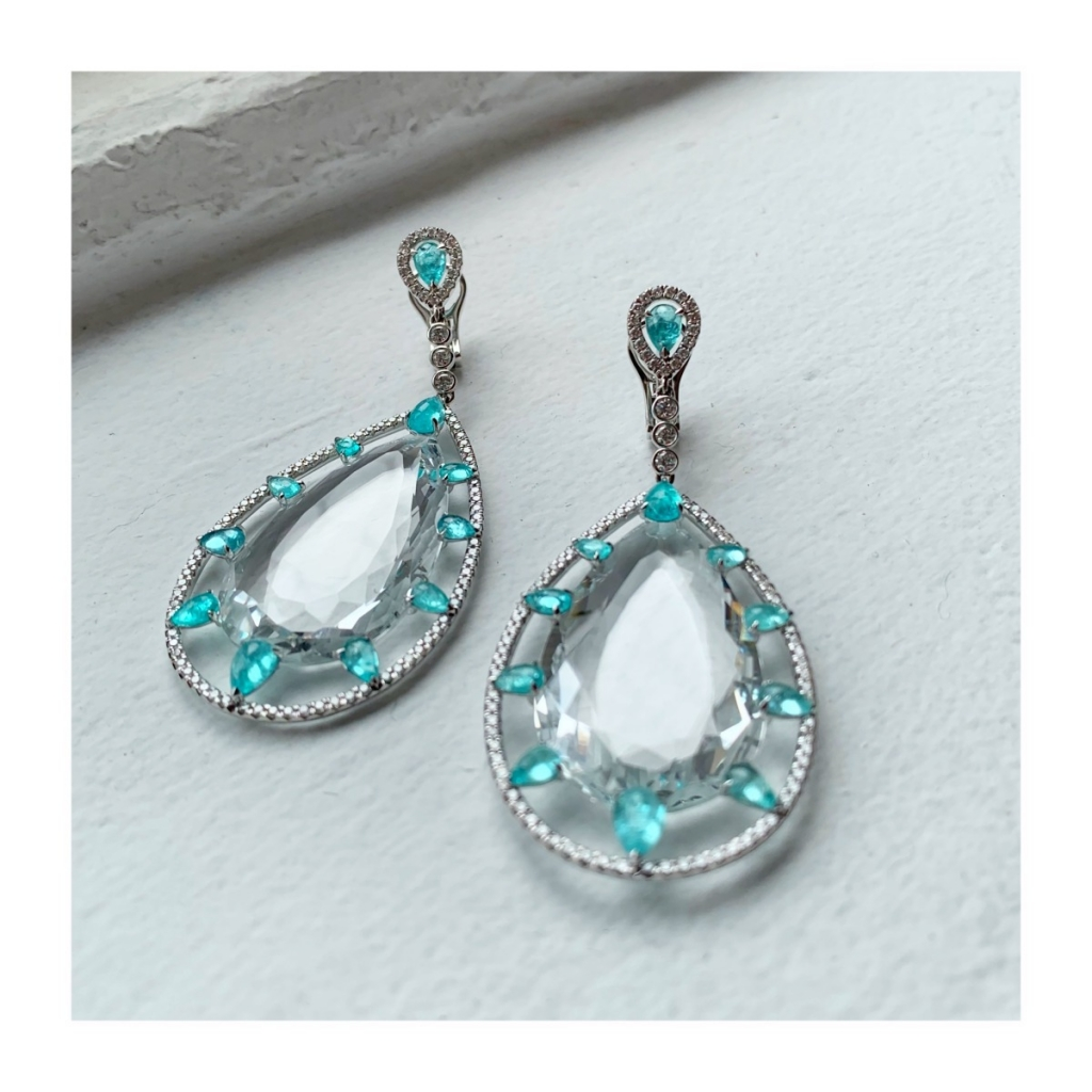 Earrings in 18k white gold with 70.61 cts. t.w. colorless topaz, 4.81 cts. Paraiba tourmaline, and 1.55 cts. t.w. diamonds by Nin Zaridze of NZR Jewelry