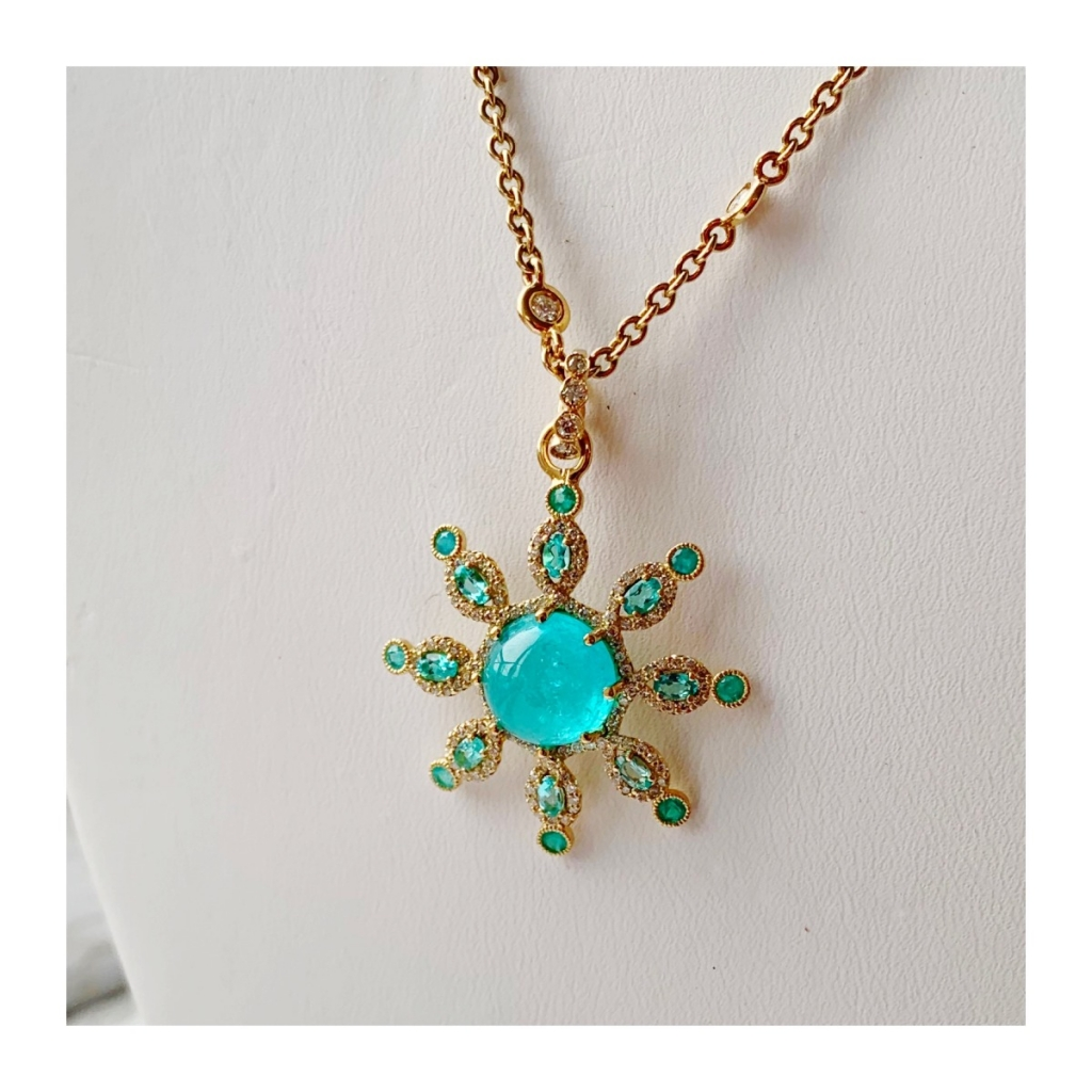 Pendant in 18k yellow gold with a 5.24 ct. Paraiba tourmaline, 2.24 cts. t.w. diamonds, and 0.88 ct. t.w. Paraiba tourmalines by Erica Courtney