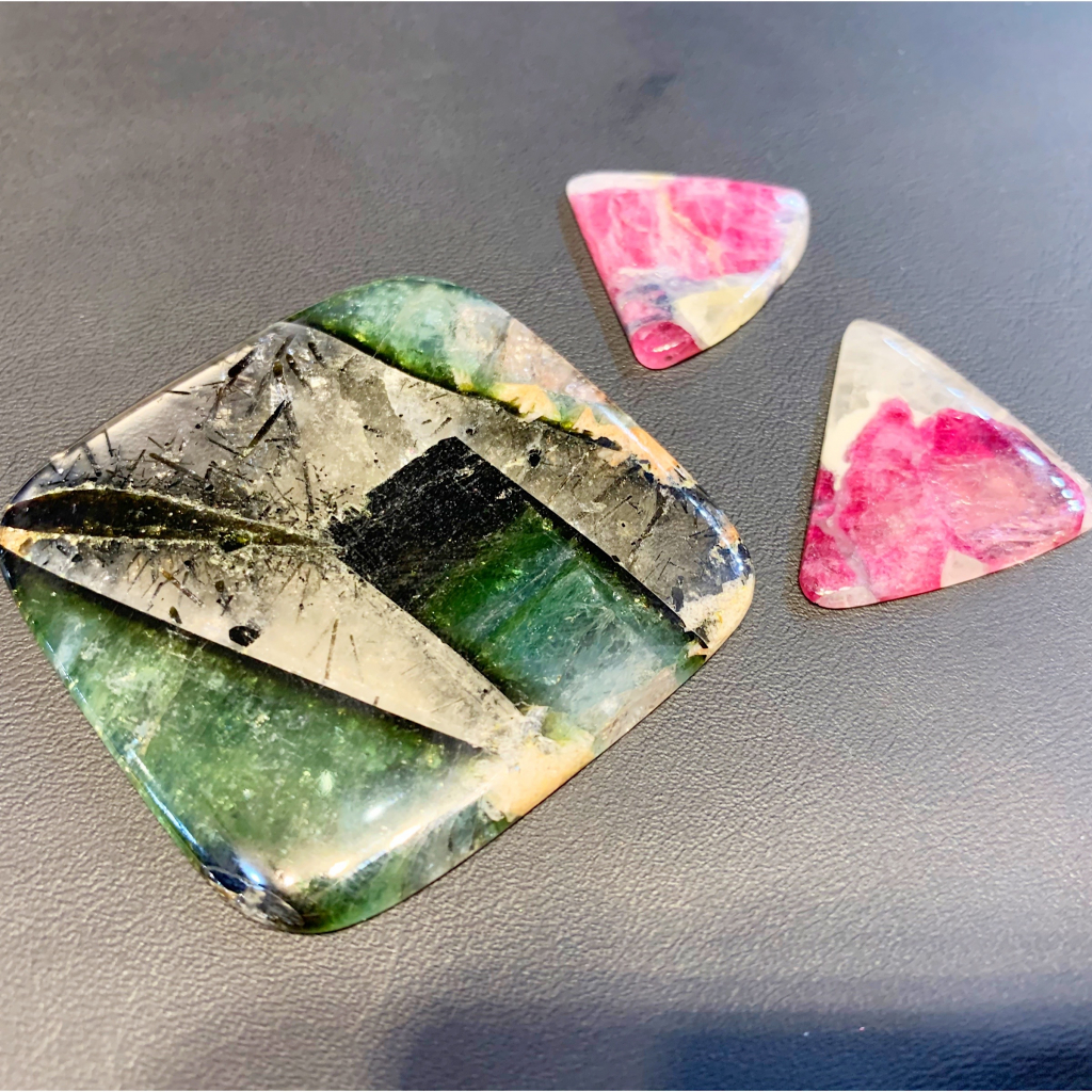Watermelon tourmaline low-dome cabochons and cushion shapes are $6 per gram triple keystone; email bill@gangigems.com for purchase.