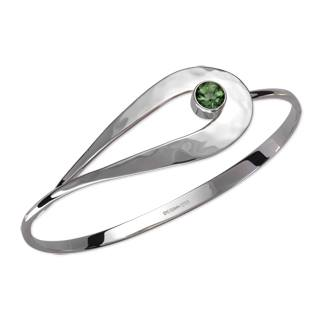 Cleo bracelet in sterling silver with green topaz, $300; by Ed Levin, available online at Von Bargen's Jewelry