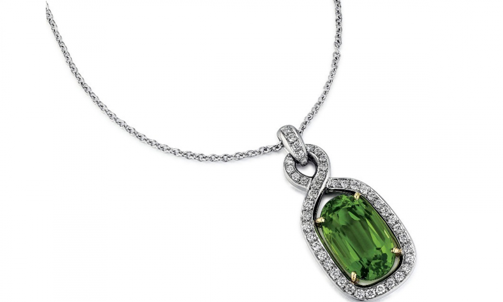 Pendant necklace in platinum with an 11.38 ct. peridot and 0.60 ct. t.w. diamonds, $13,600, Suna Bros.; email danielle@sunabros.com for purchase