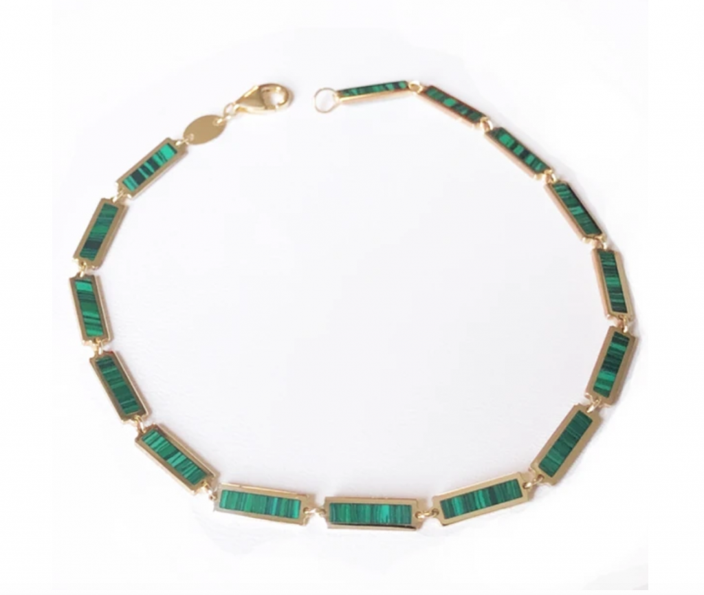 Boheme La Mini Belle inlay bracelet in 14k yellow gold with malachite (each rectangle is 10 mm. long and 3 mm. wide), $515; available online at Delphine Leymarie