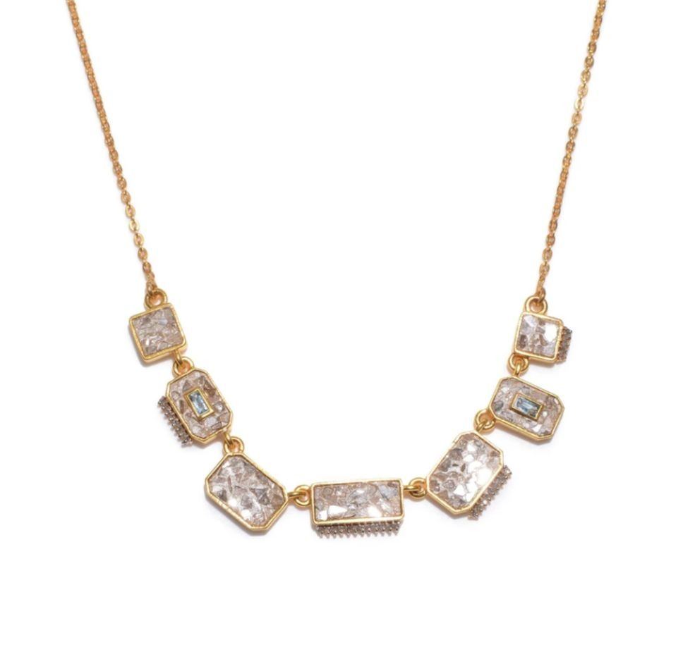 Halki necklace in 18k gold vermeil with uncut diamonds, aquamarine, and silver resin, $548; available online at Shana Gulati