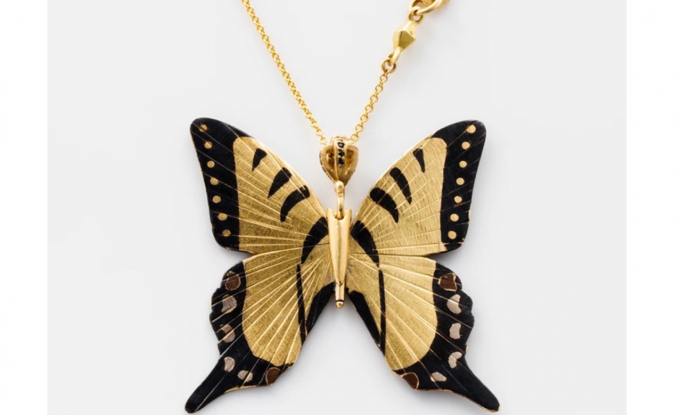 Tiger Swallowtail, a large, hinged articulating butterfly necklace with 14k rose and 18k white and yellow gold in Shakudo (a Japanese method of colorizing metal) and black diamond accents on an 18k yellow gold chain, $9,000; available online at James Banks Design