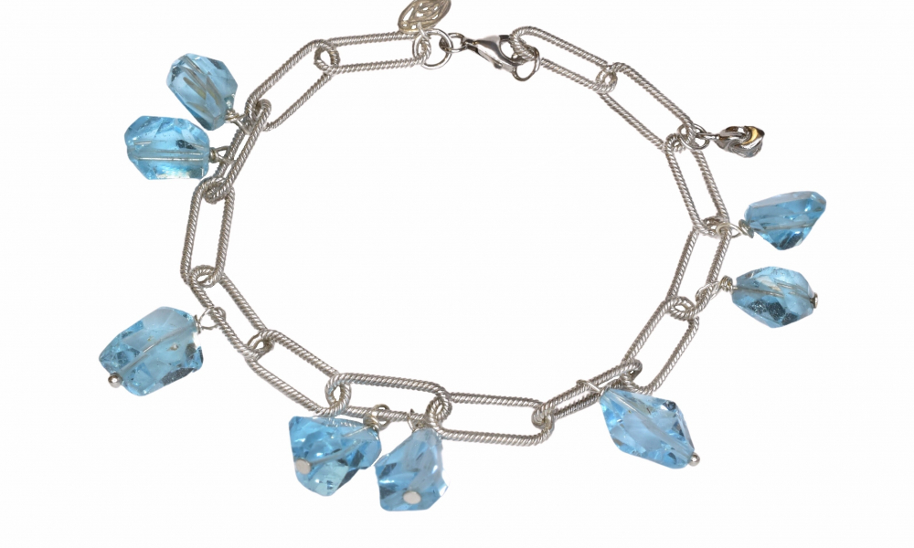 Charm bracelet in sterling silver with faceted blue topaz, $240; available online at Stephanie Occhipinti