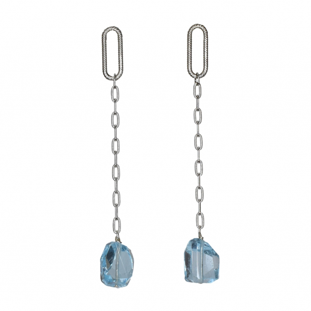 Line earrings in sterling silver with faceted blue topaz, $85; available online at Stephanie Occhipinti