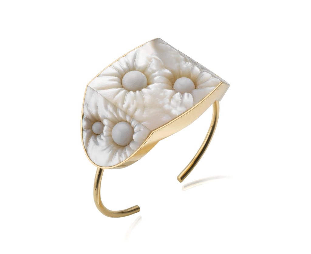 Embedded bracelet in recycled 18k yellow gold with white mother-of-pearl and 11 cts. t.w. white hippopus pearls, £16,200; available online at Melanie Georgacopoulos