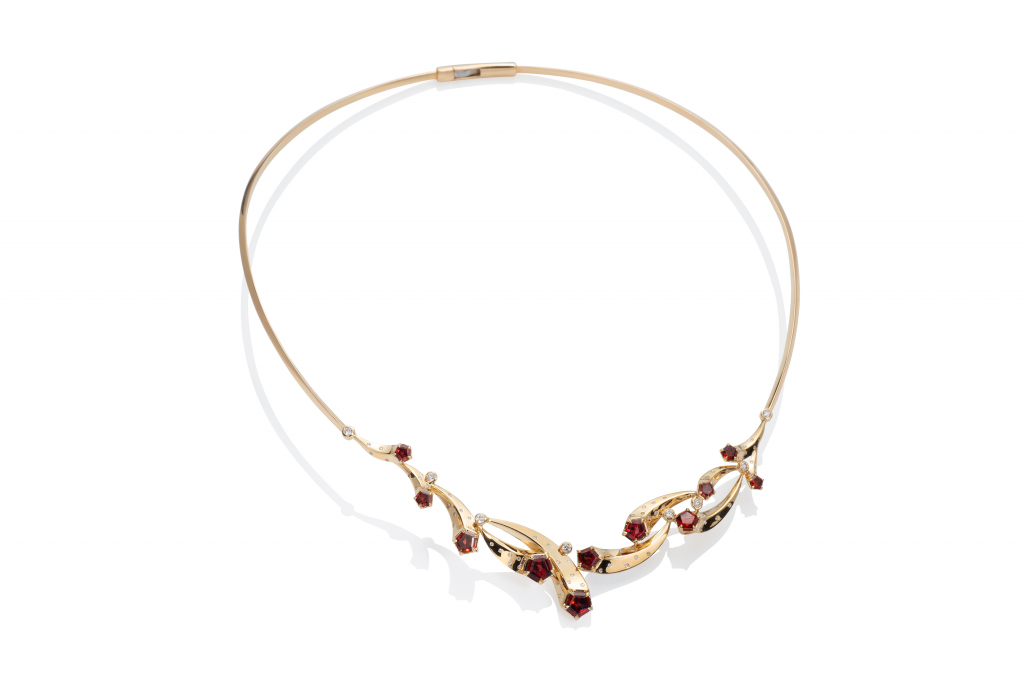 Comet necklace in 14k gold with back hinge and front opening, Madeira garnets, and diamonds, $6,135; available online at Martha Seely