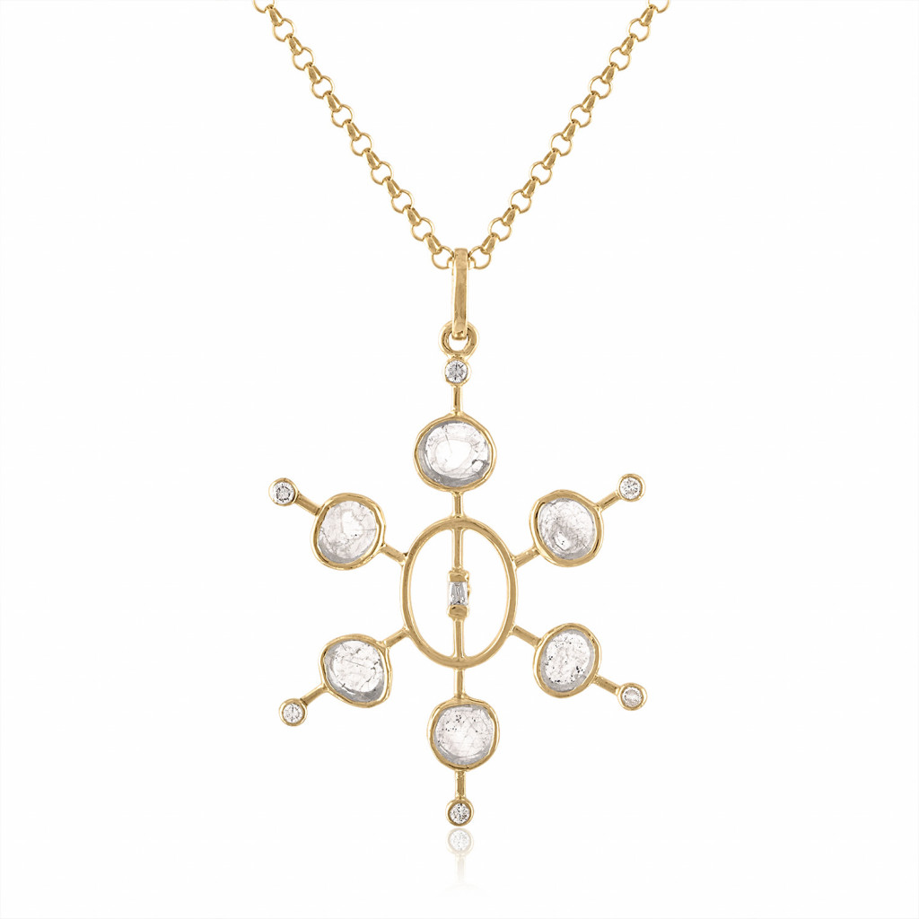 Slice pendant necklace in 14k yellow gold with 0.79 cts. t.w. diamonds, $1,490; Loriann Jewelry, available online at Loriann Jewelry
