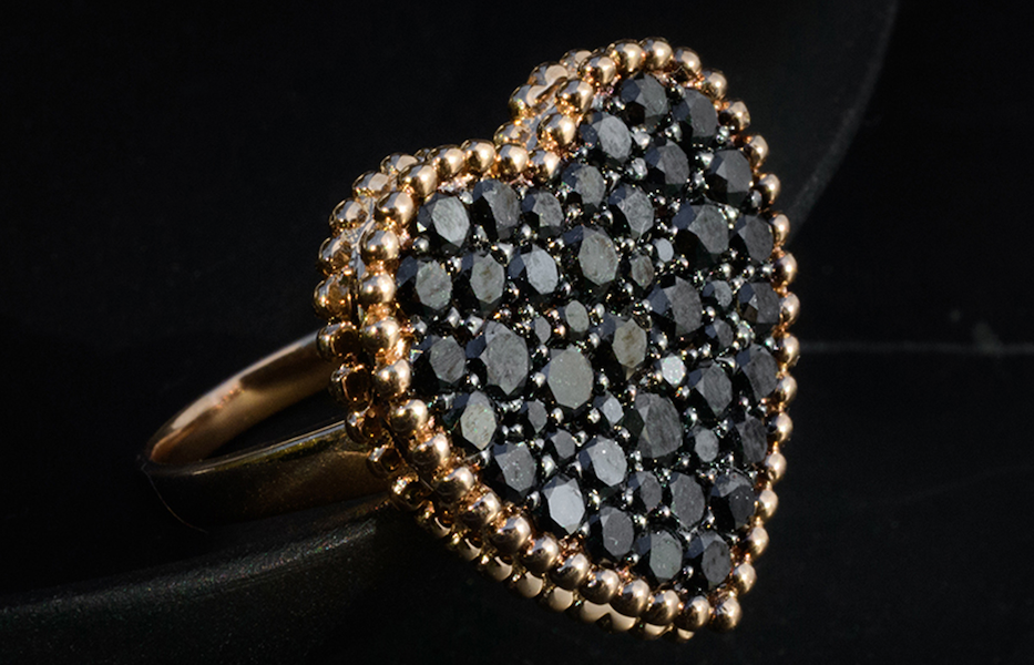 Amor ring in 18k rose gold with black diamonds, $3,900; available online at Rosa Van Parys