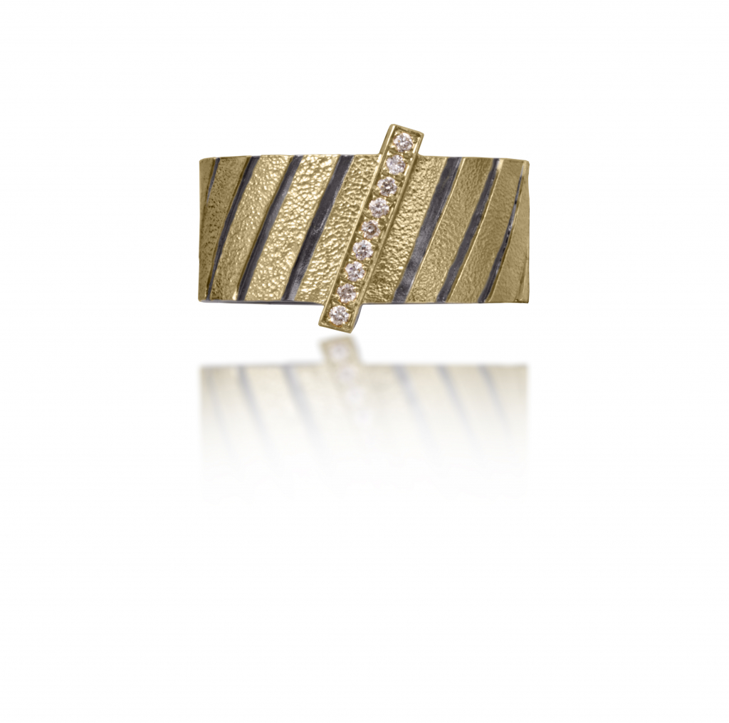 Stripe ring in 18k gold and oxidized sterling silver with 0.9 ct. t.w. diamonds and  a hand-fabricated, stipple-textured and engraved surface, $1,630; available online at Elizabeth Garvin