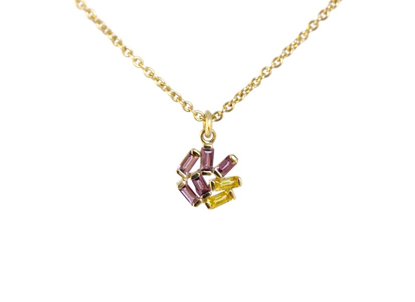 Small Jubilation necklace in 14k yellow gold with 5 amethyst baguettes and two yellow sapphires that are each 3.0 by 1.5 mm, $840; available online at Emily Kuvin