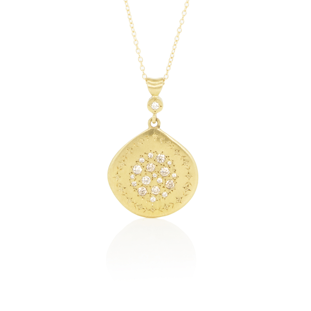 Pendant necklace in 18k yellow gold with 0.26 ct. t.w. champagne-color diamonds, $3,365; available online at Adel Chefridi