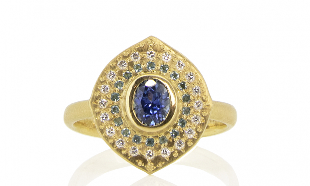 Ring in 18k yellow gold with 0.80 ct. t.w. blue sapphires, aquamarines, and 0.12 ct. t.w. diamonds, $3,495; available online at Adel Chefridi