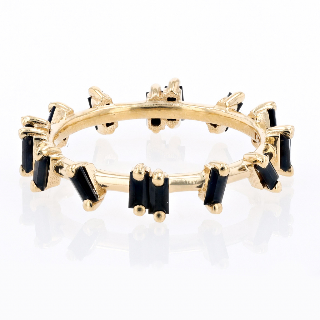 Eternity band in 18k yellow gold with 0.85 ct. t.w. baguette-cut black sapphires, $1,000; email info@suzannekalan.com for purchase