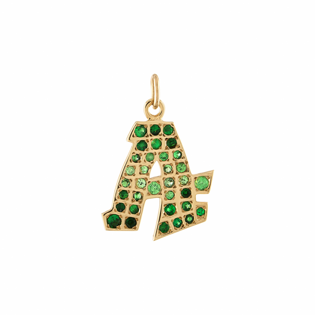 Grafitto heart charm in 14k gold with tsavorite garnets, $1,700; available online at Gigi Ferranti