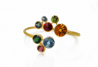 Bracelet in 18k yellow gold and platinum with 4.26 cts. t.w. aquamarine, 3.73 cts. t.w. spessartite garnet, 3.03 cts. t.w. citrine, 2.19 cts. t.w. tourmalines, 0.73 ct. t.w. peridot, $19,040; email Tom Munsteiner at munsteiner@t-online.de for purchase