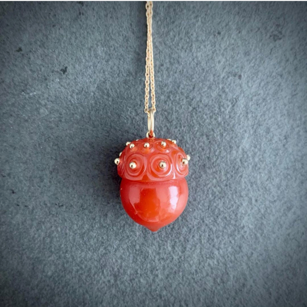 Carved carnelian acorn with 14k gold (charm only, no chain), $1,685. Shop @sophiegardnerjewelry on Instagram.