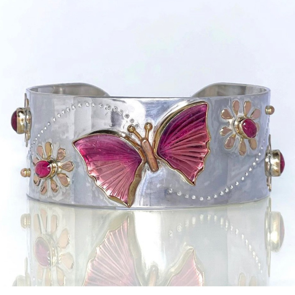 Cuff in sterling silver with 14k gold accents with a 12.3 ct. pink and orange tourmaline butterfly and 0.13 cts. t.w. rubellite tourmalines, $2,699; available online at Jen Volkodav Jewelry Design