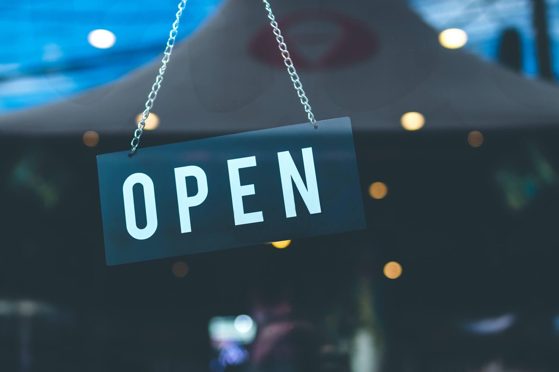 Restaurant open sign hanging in window