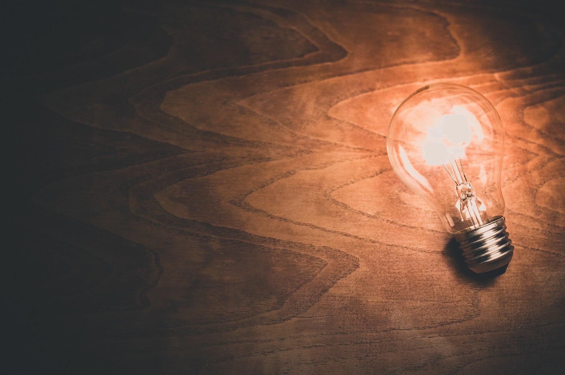 Light bulb idea concept on wood background
