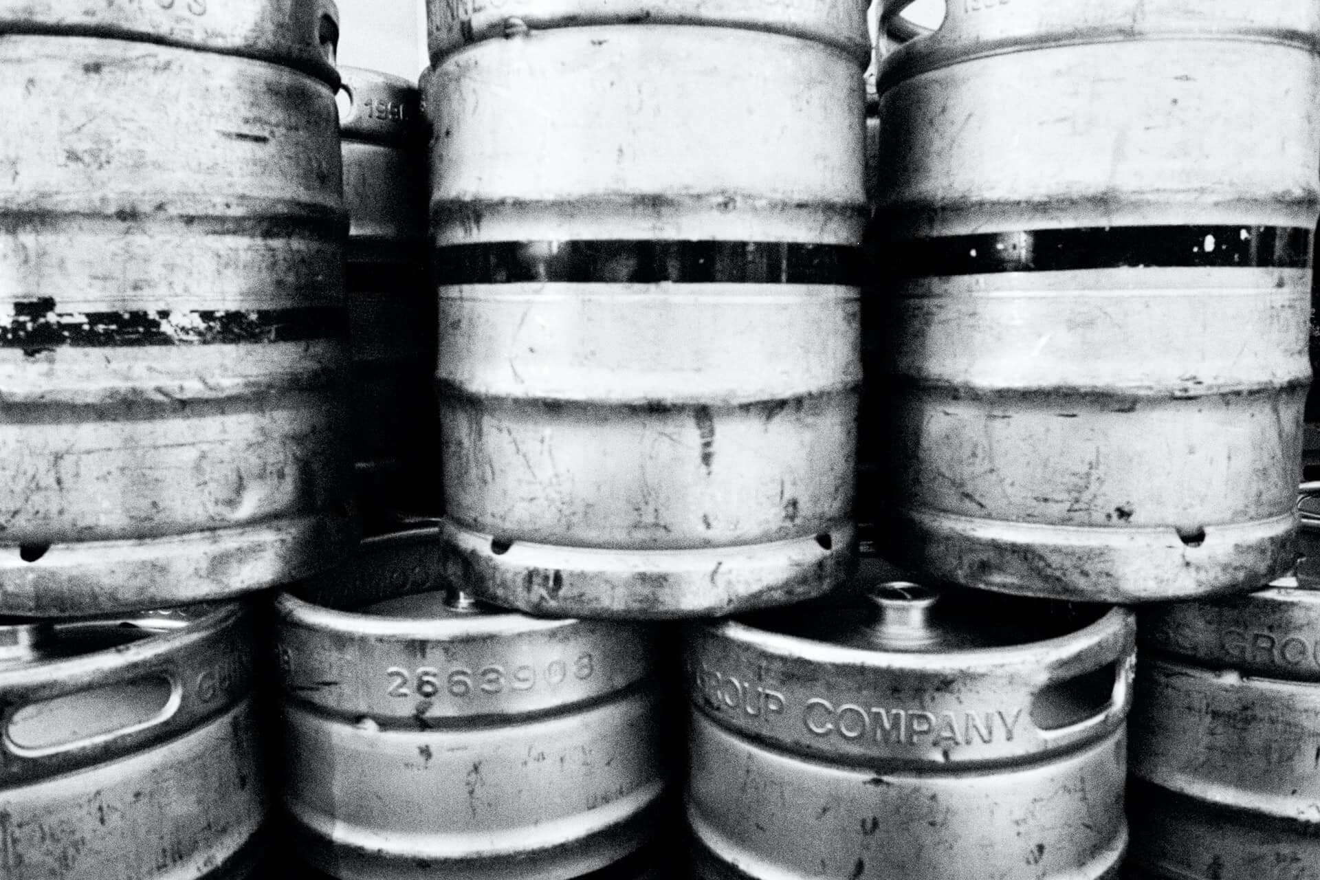 Stack of beer kegs in black and white