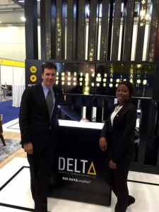 Keith Teichmann, Chief Marketing Officer, in front of Delta's booth.