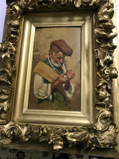 Man Lighting Pipe, unsigned, in frame, private collection