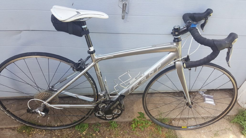 Emily's first real bike: silver Felt ZW road bike.