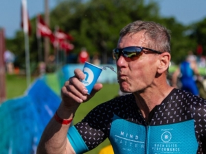 Athlete drinking water from one of the aid stations on course