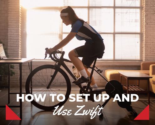 Female cyclist rides her indoor trainer while following Zwift on her laptop. Text in design reads How to Set Up and Use Zwift. Learn more at https://therookietri.com/zwift-guide/