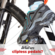 Image shows a cyclist's foot on the clipless pedal on their bike. Text on design reads What are Clipless Pedals. Read more at https://therookietri.com/clipless-pedals-explained/